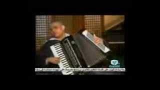 اسامة ابراهيم عازف الاكورديون في برنامج دروس تعليم الموسيقى العربية تعليم الاكورديون 1 الفنان د ياسر
