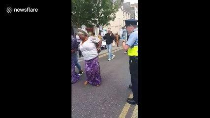 Funny scene as Irish police dances with Africa Day attendees
