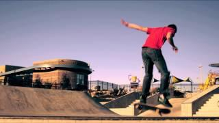 Shot Of A Skateboarder Doing A Frontside 360 Out Of A Ramp At A Skatepark.